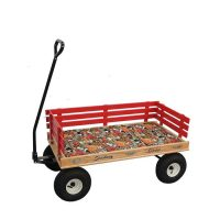 Cushion laying flat in a little red wagon for kids